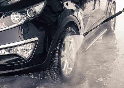 Washing car. Close up.  High Pressure Water.